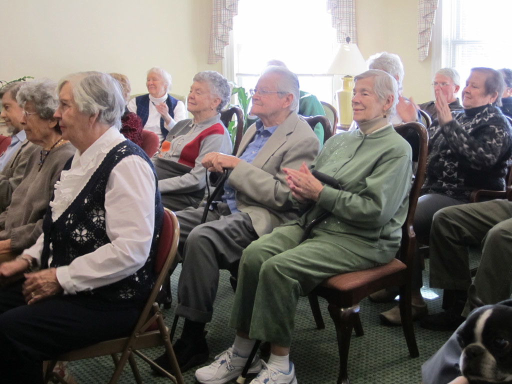 Residents enjoying a performance