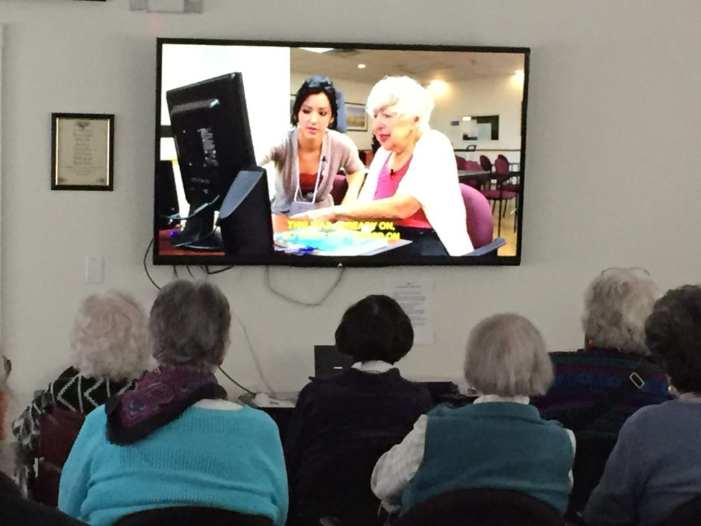 "Residents and guest attend a special ""Cyber Seniors"" event"